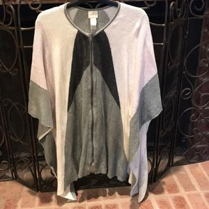Zip up poncho type cotton sweater with sleeves.